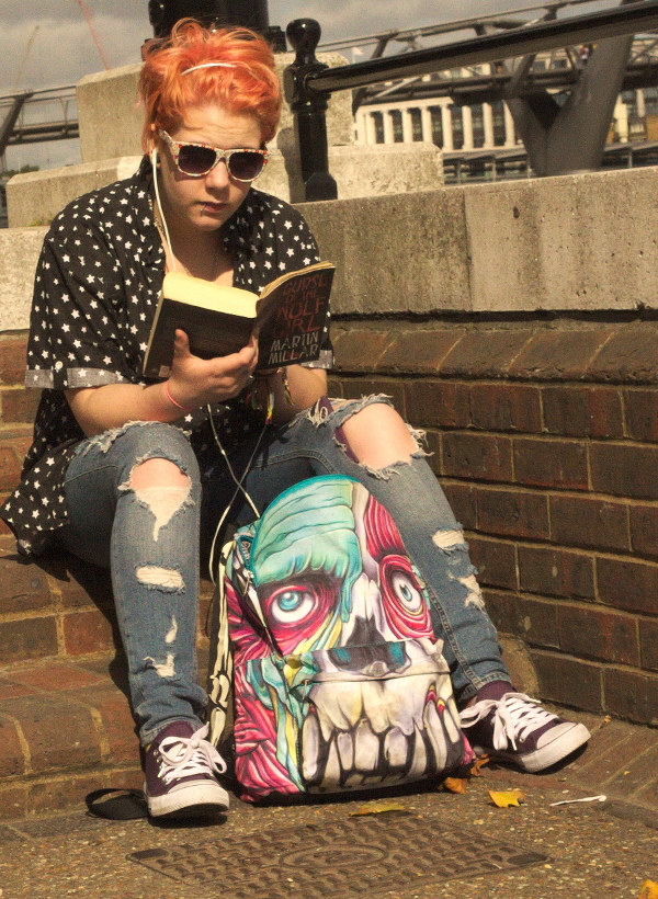 Ripped jeans and shades Fashionista, London